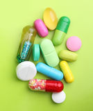 Various pharmaceuticals. Pills on green background stock image