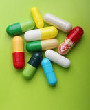 Various pharmaceuticals. Pills on green background stock photos