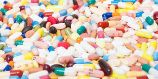 Various pharmaceuticals. Various pills and other pharmaceuticals background texture royalty free stock image