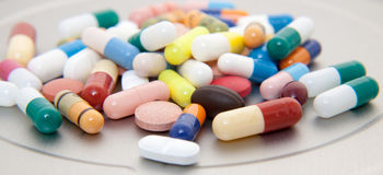Various pharmaceuticals. On stainless steel background stock image