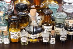 Various pharmacy bottles of homeopathic medicine. On dark background royalty free stock photo