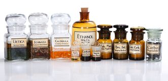 Various pharmacy bottles of homeopathic medicine Royalty Free Stock Images