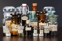 Various pharmacy bottles of homeopathic medicine Royalty Free Stock Photo