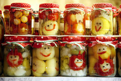 Various pickled vegetables in glass jars on retail market for sale Royalty Free Stock Photography