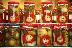 Various pickled vegetables in glass jars on retail market for sale Royalty Free Stock Photos