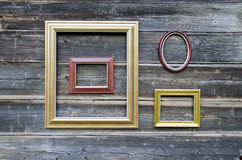 Various picture frame on old wooden wall Royalty Free Stock Photos