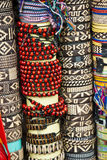 Various pieces of bracelets. Street market - Souvenirs - Various pieces of jewelry - Bracelets - Woven bracelets - String bracelets -Wooden beads bracelets Stock Images