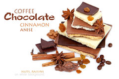 Various pieces of chocolate with nuts, raisins and coffee beans Royalty Free Stock Images
