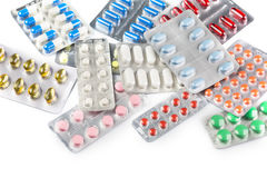 Various pills and Capsules on the White background Royalty Free Stock Photos