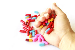 Various pills in hand Stock Photo