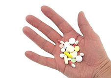 Various pills in hand, on white background Royalty Free Stock Image