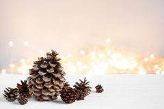 Various pine cones and garland on the wooden table Royalty Free Stock Images