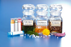 Various plant extract in bottles and homeopathic medication Stock Image