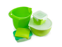 Various plastic food storage and cooking containers for home use. Several different green reusable plastic food storage and cooking containers, some with covers Stock Photography