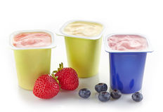 Various plastic yogurt pots Stock Photography