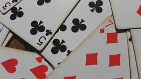 Various playing cards rotate on table. stock video