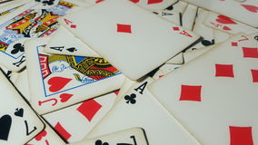 Various playing cards rotate on table. Macro shot stock video