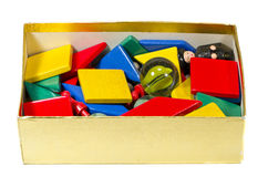 Various playthings in the box. Various playthings in the golden painted box Stock Photo