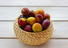 various plums in a wicker pot - autumn gifts Stock Image