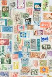 Various postage stamps. Postage stamps from different countries Royalty Free Stock Photos