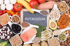 Potassium food sources, top view. Various potassium food sources such as grains, fruit and vegetables, top view royalty free stock images