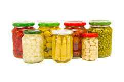 Various potted vegetables glass jars isolated on white Royalty Free Stock Image