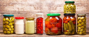 Various preserved food. On a wooden background Royalty Free Stock Photography