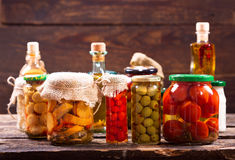 Various preserved food on wooden table Royalty Free Stock Photo