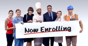 Various professional holding placard of now enrolling text. Portrait of various professional holding placard of now enrolling text against white background stock footage