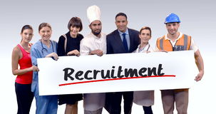 Various professional holding placard of recruitment text. Portrait of various professional holding placard of recruitment text against white background stock video