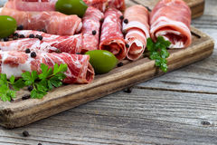 Various raw meats on serving board with rustic background Stock Photo