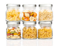 The various raw pasta in a glass jar Stock Images