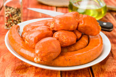 Various raw sausage on rustic wooden Royalty Free Stock Image