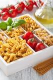 Various raw wholegrain pasta in white wooden box.  Royalty Free Stock Photo