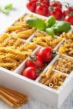 Various raw wholegrain pasta in white wooden box Royalty Free Stock Photos