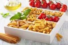 Various raw wholegrain pasta in white wooden box Royalty Free Stock Photo