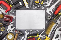 Various renovation instruments and tools on grey background. scr Royalty Free Stock Photography