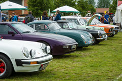Various retro cars standing in a row in the exhibition field Royalty Free Stock Images