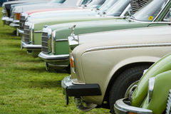 Various retro cars standing in a row in the exhibition field. Royalty Free Stock Image