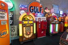 Various retro jukeboxes and retro refrigerator Coca-Cola Stock Photography