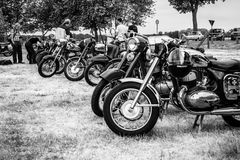 Various retro motorcycles stand in a row. Stock Photography