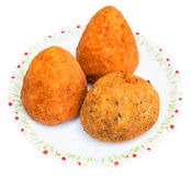 Various rice balls arancini on plate isolated. Traditional sicilian street food - various rice balls arancini on plate isolated on white background Stock Photo
