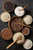 Various rice in bowls Stock Images