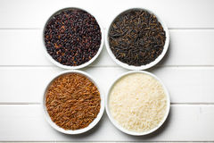 Various rice in ceramic bowls Stock Image