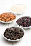 Various rice in ceramic bowls Royalty Free Stock Photo