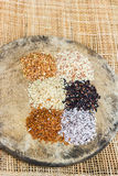 Various rice types each within an individual pile on rustic wood Royalty Free Stock Photo