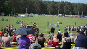 Various riders horse. Panorama of people watch various riders in annual public horse festival on June 01, 2013 in Niuronys, Lithuania stock video footage