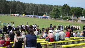Various riders horse. People watch various riders in annual public horse festival on June 01, 2013 in Niuronys, Lithuania stock video