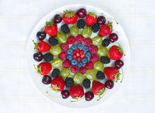 Various ripe berries on the round plate Stock Photo