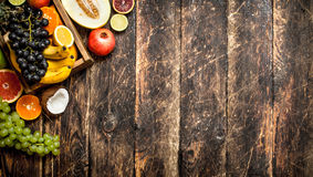 Various ripe fruits in a wooden box. Royalty Free Stock Photo